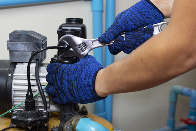 worker engineer maintenance repair gasget value of water pump